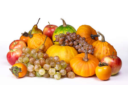 Autumn harvest isolated on white background. Pumpkins, apples, grape bunch, peers and kinglet.