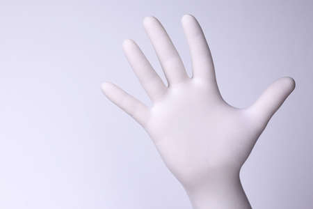 White hand. Hand with white glove on light background.