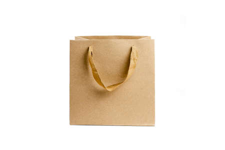 Recycled craft paper bag on white. Shopping paper bag isolated on white background. Paper bag mock up for design.