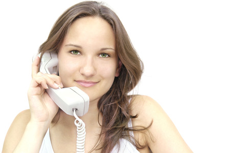 beautiful young smiling girl with a telephone