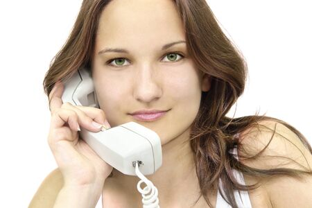 close-up of a beautiful  young girl with telephone                                photo