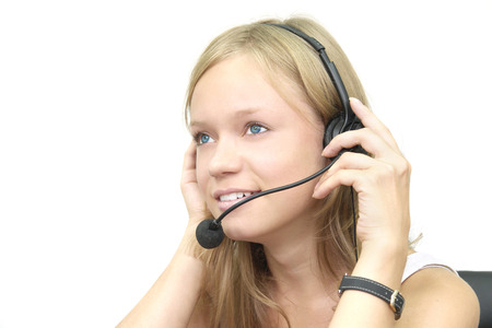 friendly smiling beautiful young girl with telephone headset                                photo