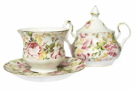teacup on saucer and sugar bowl decorated with flowers                                Stock Photo