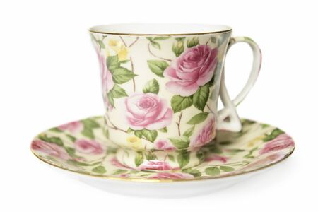 teacup on sucer decorated with pink roses                                photo