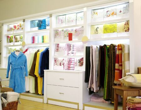store of colorful bed linen, towels and dressing gowns                                Stock Photo