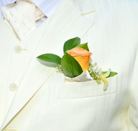 luxurious grooms wedding suit with a flower boutonniere Stock Photo