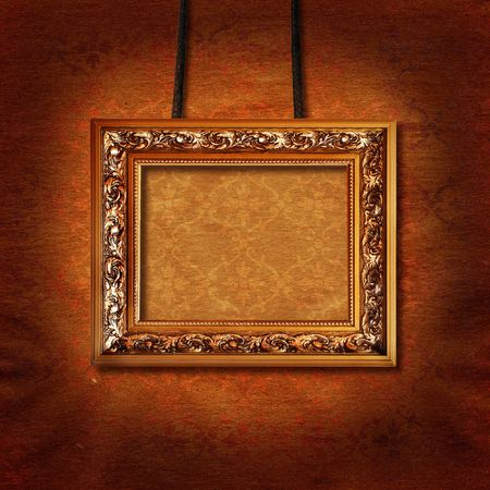 decorative bronze picture frame hung on vintage wall
