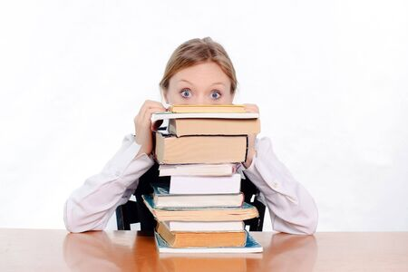 pretty female student surprised and scared of how many books she has to study