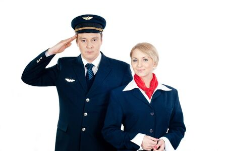 two young flight attendants isolated on white background Stock Photo