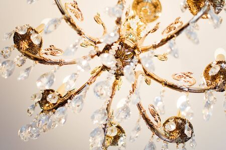 close-up of a crystal chandelier (focus on metal details) photo