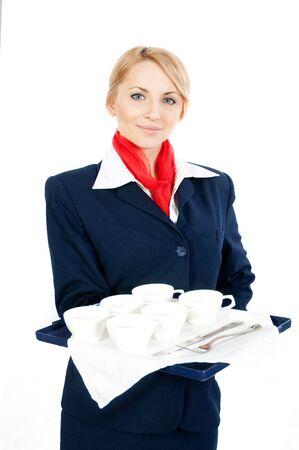 pretty young stewardess offering tea or coffee