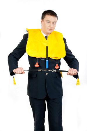 male steward showing how to use a life jacket