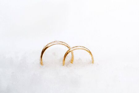 beautiful background with two gold wedding rings Stock Photo
