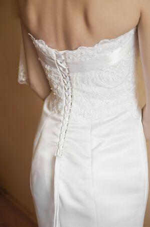 a beautiful traditional white wedding dress detail Stock Photo - 7116757