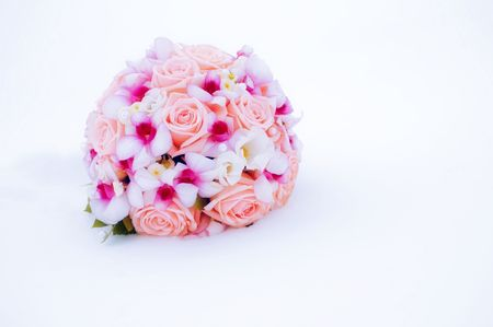 beautiful pink and purple wedding bouquet on the snow (winter wedding concept)