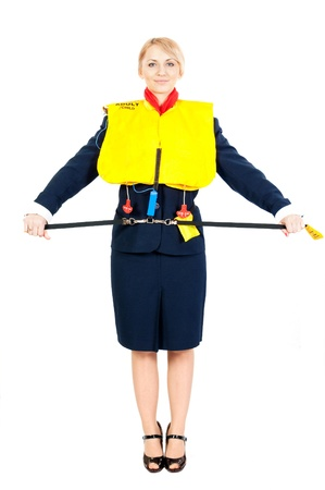 female steward showing how to use a life jacket