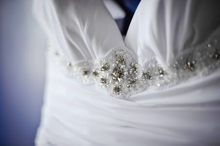 beautiful white wedding dress detail decorated with embroidery (small DOF)