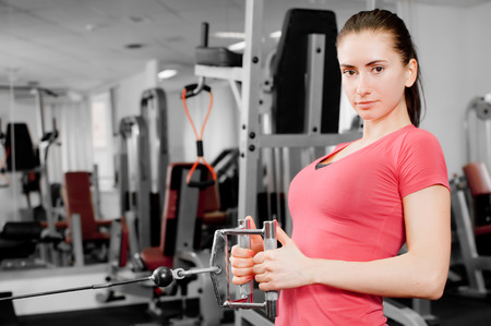 pretty young woman training in a fitness center photo