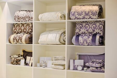 violet residential: shelves with pillows and blankets in a bedroom Stock Photo