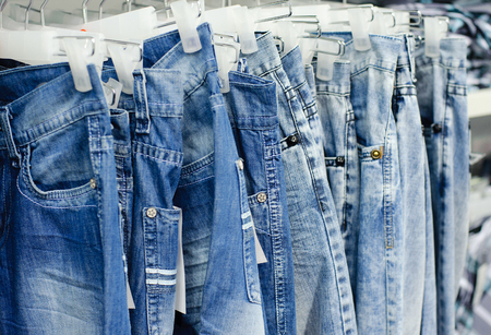 closeup of blue jeans in a shop Stock Photo