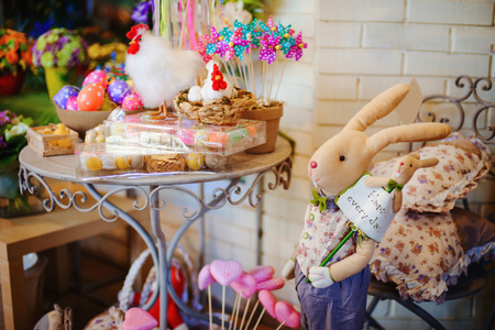 beautifully decorted Easter holiday table with hens and eggs photo