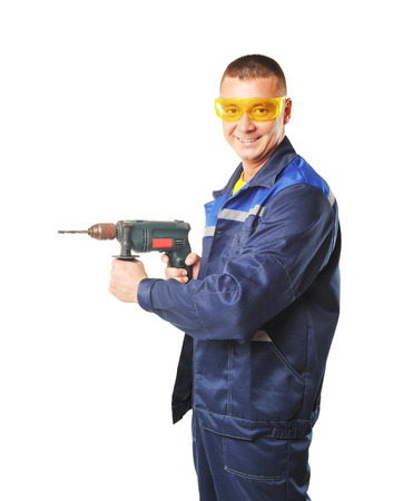 driller: young worker in uniform with a drill Stock Photo