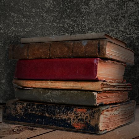 stack of old books on vintage rusted background