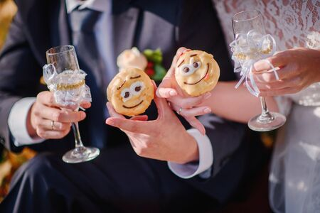 bride and groom holding their flutes with champaign Stock Photo