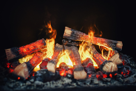 several burning wooden logs in a fireplace