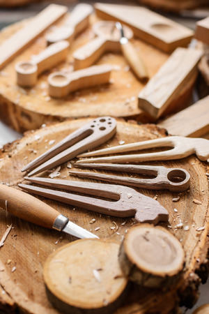 vintage looking wood carvers work place with instruments and wood cuts