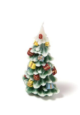 Christmas tree candle  isolated on the white background photo