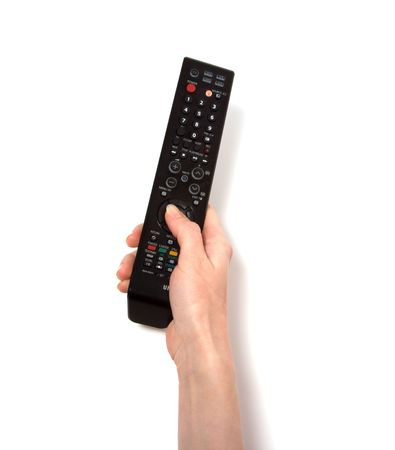 Hand holding tv remote control isolated on white background