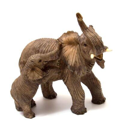 Ceramics elephant with elephant calf isolated on white background photo
