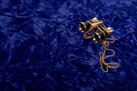 Theater concept. Opera glasses on blue velvet. Stock Photo - 5811386