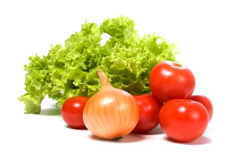 Lettuce salad and vegetables isolated on white background photo