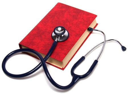 stethoscope on red book isolated on white background photo