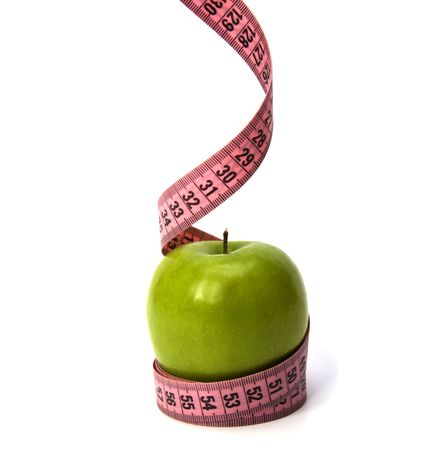 tape measure wrapped around the apple isolated on white background Stock Photo - 5958542