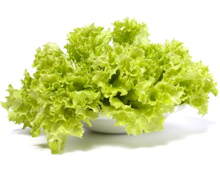 green leafy vegetables: Lettuce salad isolated on white background Stock Photo