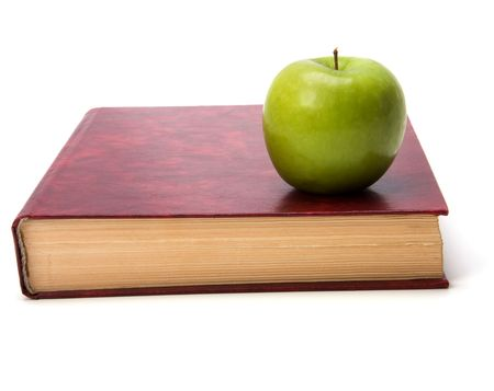 book with apple isolated on white background Stock Photo - 5973594