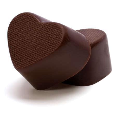 Heart shaped chocolates isolated on white background photo