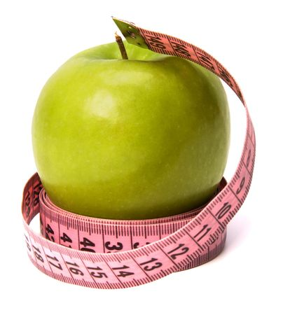 tape measure wrapped around the apple isolated on white background Stock Photo - 5982642
