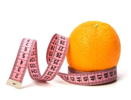 metre: tape measure wrapped around the orange isolated on white background