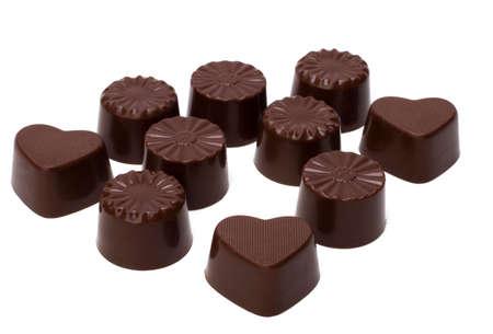 chocolate pralines isolated on white background photo