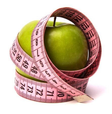 metre: tape measure wrapped around the apple isolated on white background