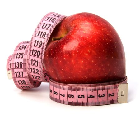 tape measure wrapped around the apple isolated on white background photo