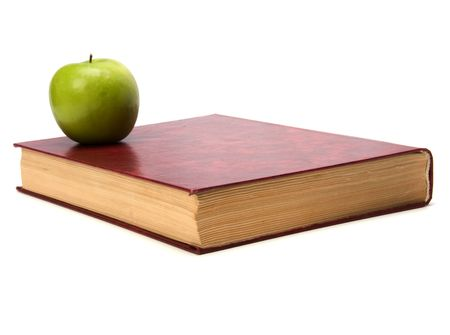 book with apple isolated on white background photo