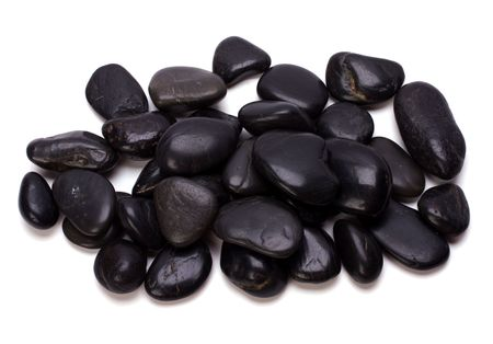 Heap of black pebbles isolated on white background photo
