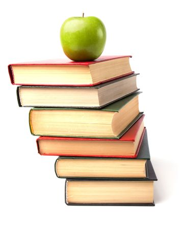 book stack with apple isolated on white background Stock Photo - 6239901