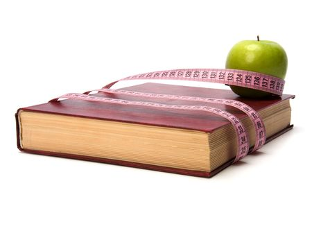 tape measure wrapped around book isolated on white background photo