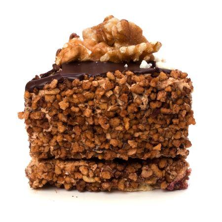 Slice of chocolate cream cake isolated on white Stock Photo - 6258719